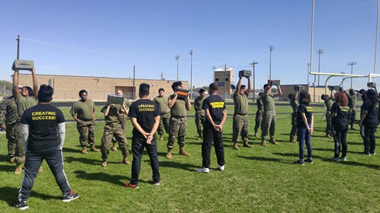Houston Can Academy - Southwest - Military Troop Climbs Obstacles